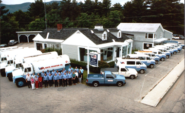 overhead shot of fuel trucks, people and building