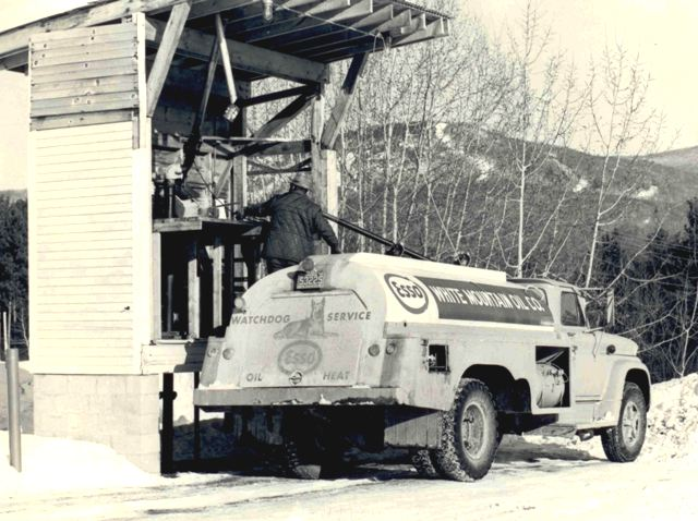 vintage photo of fuel truck loading